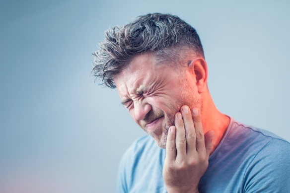 Teeth Problem, young man suffering from tooth pain, caries