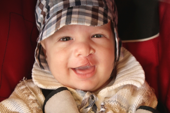 Happy baby is smiling